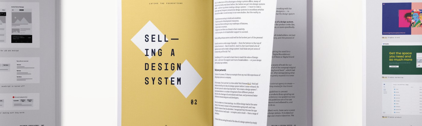 A book spread showing content related to selling a design system