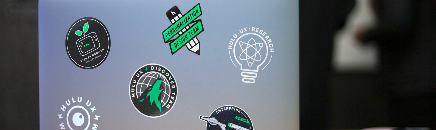 A laptop with the design team stickers