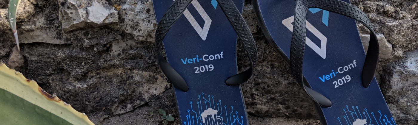 Verifa-branded flip-flops against stone background