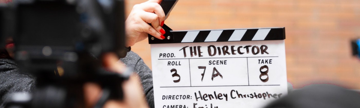 A film clapboard in action on a movie set
