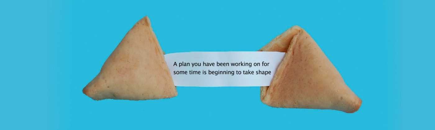 """A fortune cookie saying """"A plan you have been working on is beginning to take shape"""" Img credit: Elena Koycheva—Unsplash"""