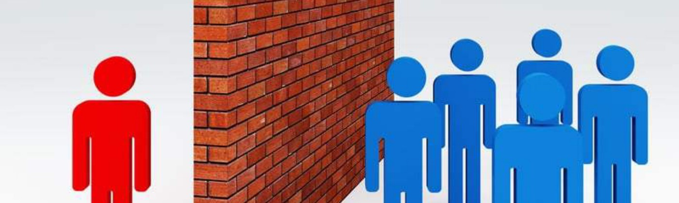 A brick wall with a red person on one side and blue people on the other