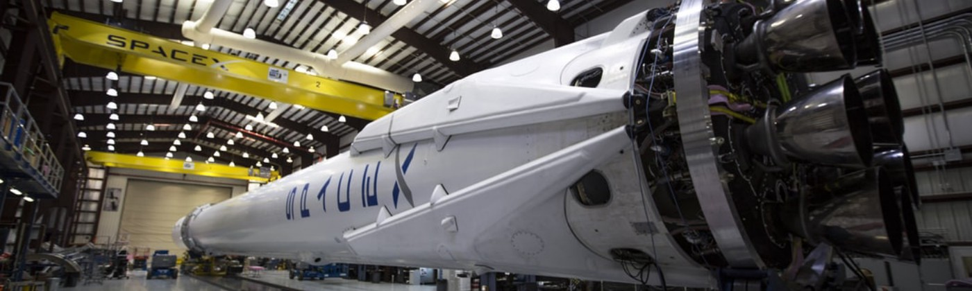 SpaceX rocket inside a hangar.