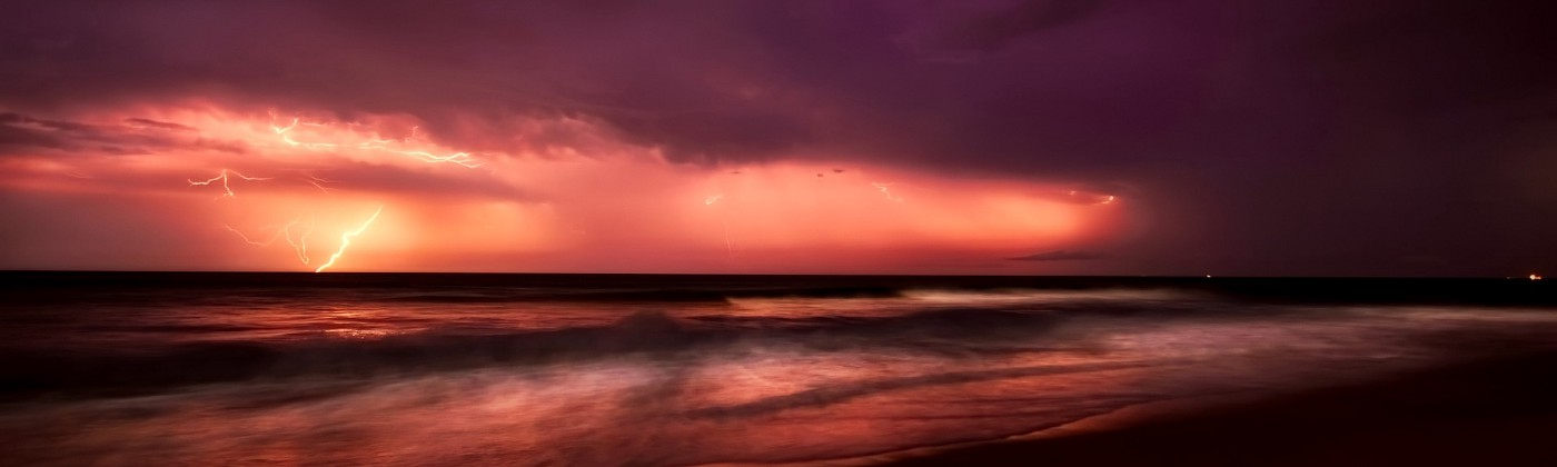 lightning storm on a beach signifying how thinking can help you speed ahead of anyone