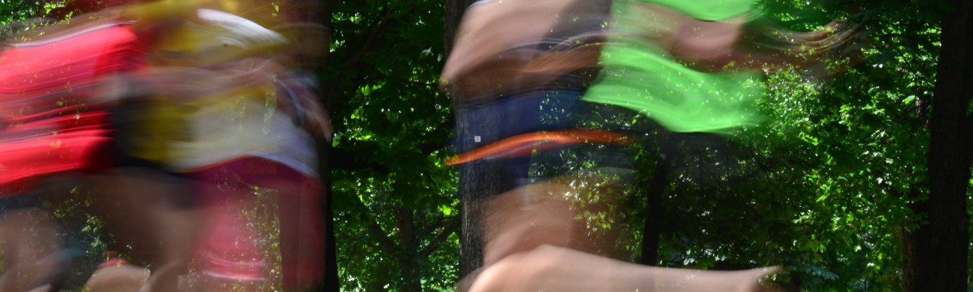 A blurred photo of people running. https://www.flickr.com/photos/neillawrencephotography/7434345350/in/album-7215763026878747