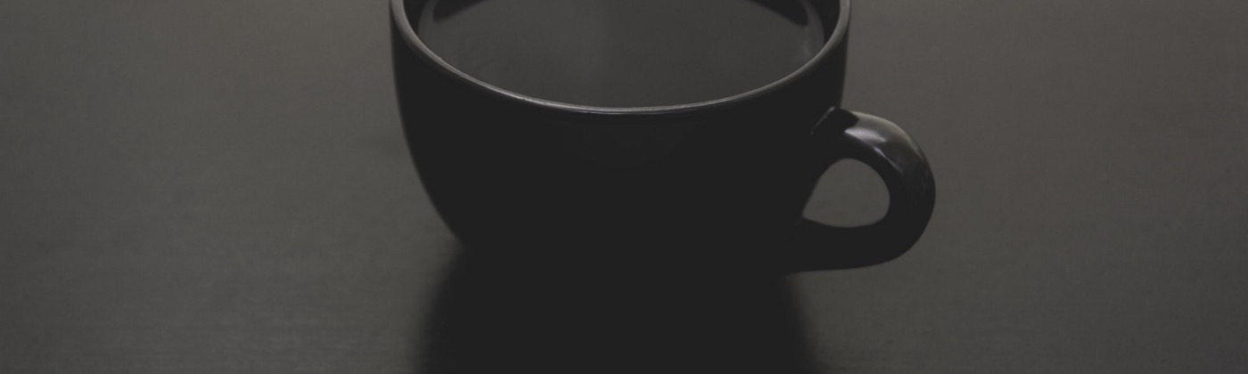 Black coffee placed on top of a quiet table