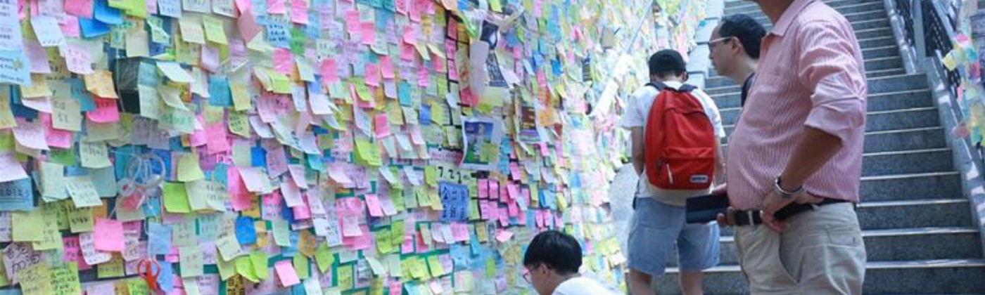 Post-it notes on a wall in Hong Kong