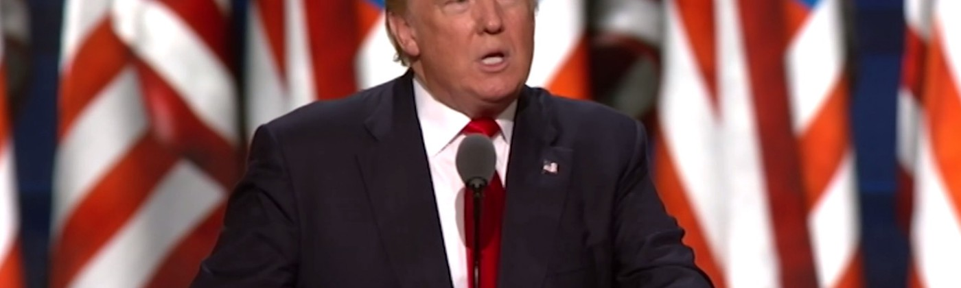Donald Trump speaks into a microphone