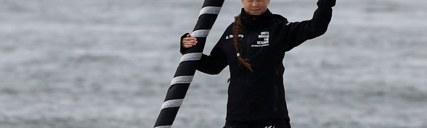 Greta Thunberg waves aboard the yacht Malizia II before setting sail for New York. August 2019