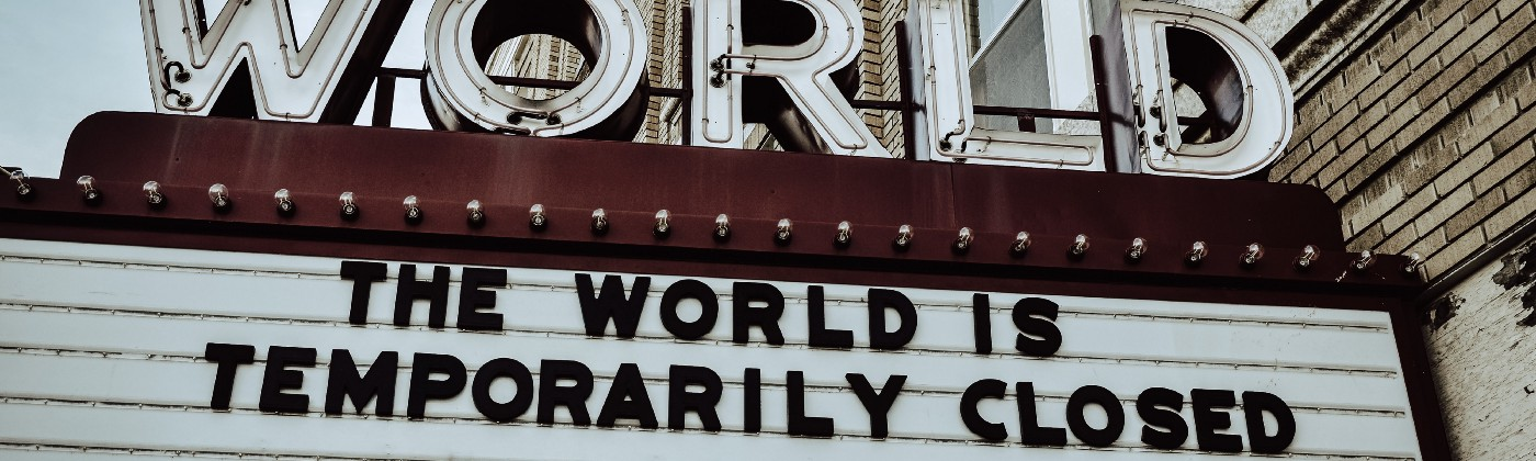 a cinema marquee that reads: The world is temporarily closed