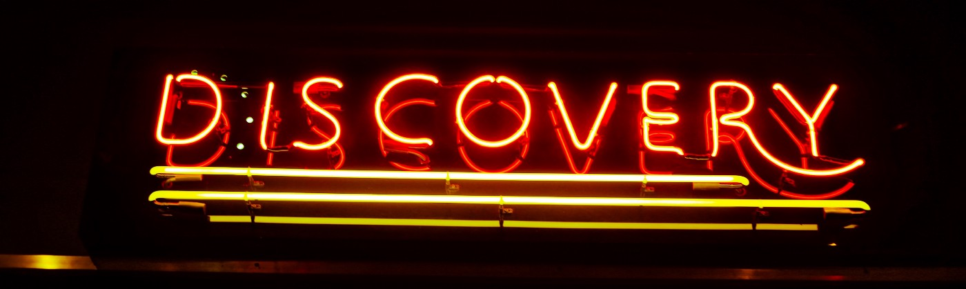 "A photo of a neon sign that reads: ""Discovery"""