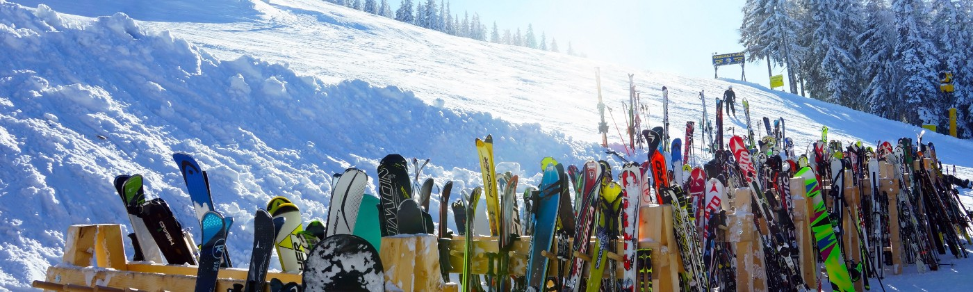 A row of skis propped up in the snow