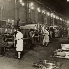 Black and white photo of women working in a factory.