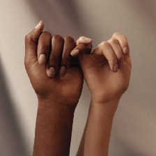 picture of two hands linked by their pinkies