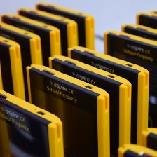rows of standing, old fashioned yellow computer discs