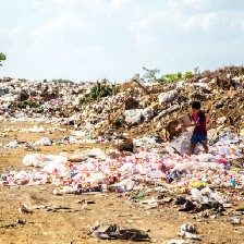 Picture of someone picking through a dump