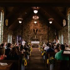 A church congregation sitting and facing front while attending a service.