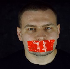 Man with tape over his mouth.