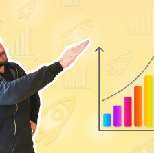 Person pointing at a chart going up.