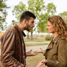 Man and woman arguing.