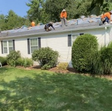 A roofing crew on our home