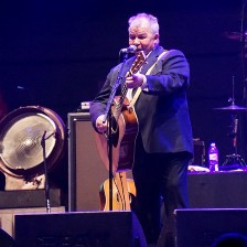 Photograph of musican John Prine Time in concert.