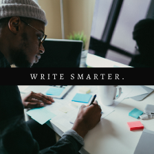 How to write on Medium article cover image. A Black person sitting in front of two monitors and writing on piece of paper. Learn how to write successfully on Medium.