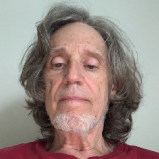 Selfie, with long pandemic hair and imperious arrogance