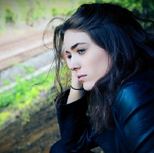 pensive woman looking at a road