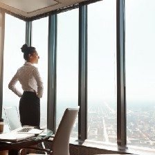 Woman staring out window.