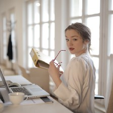 Elegant woman using her laptop while picking the best habit for her