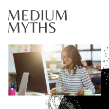 Medium myths article cover by Aigner Loren Wilson. A darker skinned person sitting in front of a computer smiling. They appear to be in an office space. Above the picture are the words Medium myths. Tips for success on Medium. Beginner info for Medium. Little known facts about Medium.