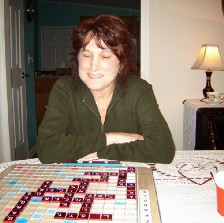 Personal photo of my wife playing Scrabble