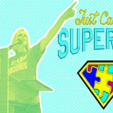 """An image of Jenny McCarthy speaking at an anti-vaccine rally, with the words """"Just Call Me Supermom"""" next to her, and a superman logo made of puzzle pieces."""