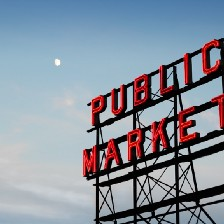 """Billboard with the words """"public market"""" against a blue sky"""