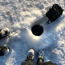looking down an ice fishing hole