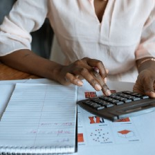 Person using a calculator at their desk