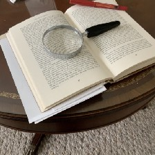 My photo of a book with a magnifying glass and red pen