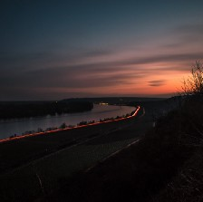 Sunset over a river and a freeway