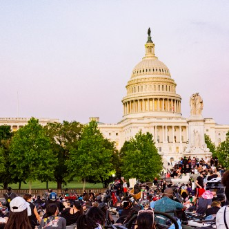 Photo of people of color and white people gathered in front of the U.S. Capitol.