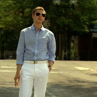 Michael Cera as Nick Twisp. Dimension Studios Trailer Still of 2009 Youth in Revolt. Teenage rebel wearing blue button up and white pants, pretending to be Francois Dillenger, Nick's bad-boy alter ego.