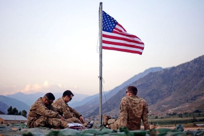 How does the USA make a profit from war?