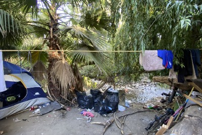 Unhoused below the San Jose river banks, these immigrants carve out their own American Dream