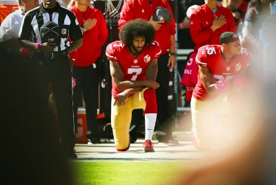 What an Announcer's Hot Mic Faux Pas Tells Us About What Many Really Believe About Kneeling During…