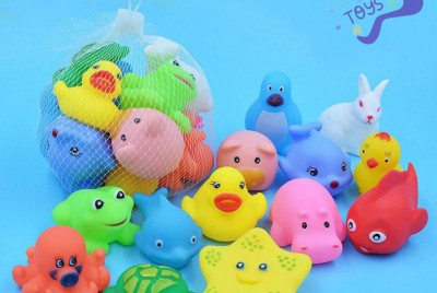 Little plastic toys that make you squeeze to squirt water out of their mouths