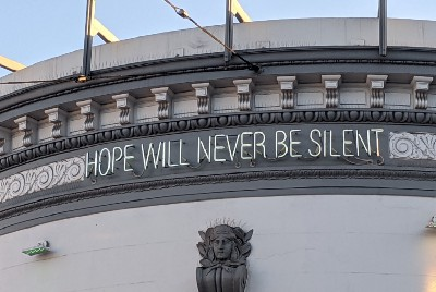 Hope will never be silent—emerging from a year of confinement.