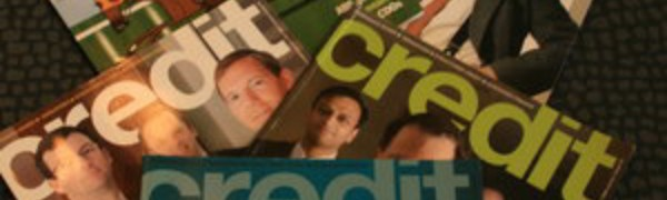 Five copies of Credit Magazine laid out on a desk — each featuring a bold masthead and pictures of bankers on the cover.