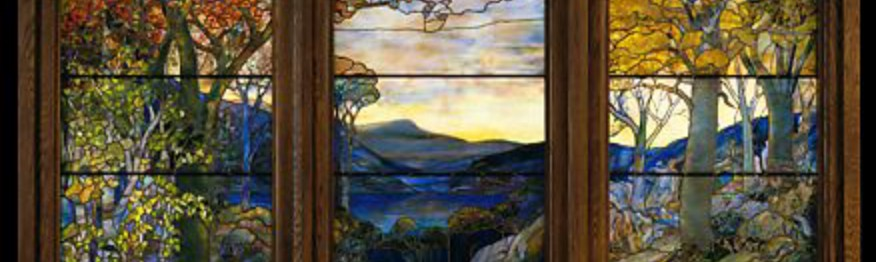 Tiffany stained glass depiction of an Autumn landscape, on display at the Met.