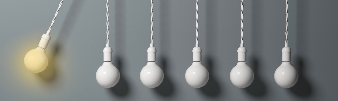Light bulb as a pendulum, hitting other lightbulbs like in a newton cradle.