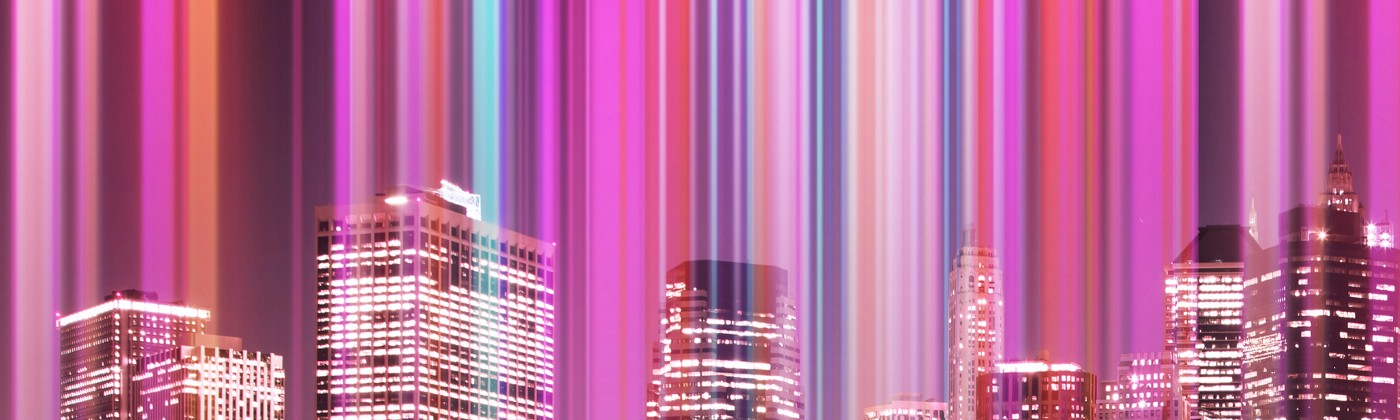 Creative picture of colorful lights emerging from Manhattan city skyscrapers at night.